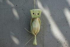 Corn silk, 3 corn leaves, toothpick, yellow paper.