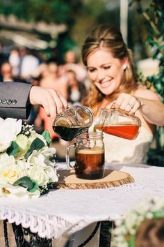 Unique wedding unity ceremony idea - Beer Pouring Ceremony (poor one light and one dark beer into one glass, take a sip!) Flowers by Flowers For You - FlowersForYouHouston.com