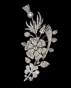 Silver and gold spray combining the emblems of the three kingdoms, the rose of England, the shamrock of Ireland and the thistle of Scotland, with the leek for the Principality of Wales, on a curved stem entirely set with cushion and brilliant cut diamonds, the rose mounted en tremblant. And open at the back. English, c. 1801.