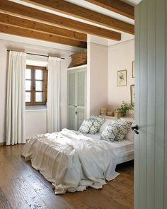 serene bedroom in wood and whites