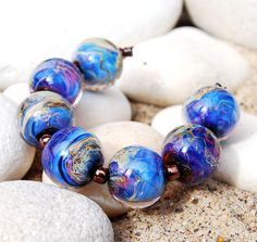 Encased Ekho Rounds by sublimebeads, via Flickr
