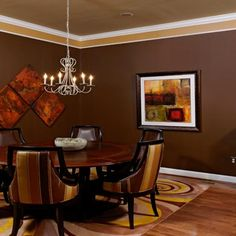Brown Dining room great use of color on ceilings!