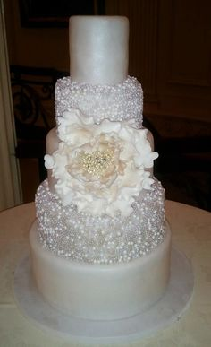 Oh so pretty all white wedding cake. This is one of our classic, elegant, and yet dramatic wedding cakes
