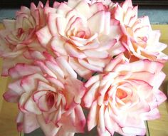 aren't these roses pretty? they're made of coffee filters!    everything you could possibly ever want to know about making coffee filter flowers