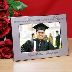 "Personalized Memories and Dreams 2015 Graduation Silver Picture Frames. Show them just how proud you are of their achievements with an attractive, Silver Graduation Frame personalized just for them. Our Engraved Memories and Dreams Silver Graduation Picture Frame features a non-tarnish, silver frame. An easel back allows for desk display. The engraved picture frame measures 5 3/4"" x 7 3/4"" and holds a 4"" x 6"" or 3 1/2"" x 5"" photograph. Free personalization is included. We will"