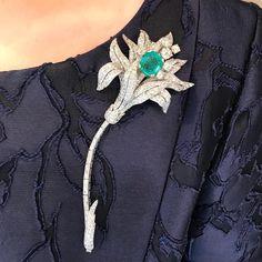 cartier diamond flower brooch emerald