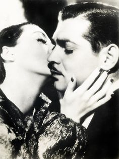 "Joan Crawford and Clark Gable in ""Love on the Run"" 1936"
