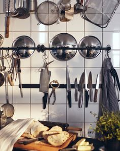 Traditional kitchens are all about showing off the details. A good start is with a knife rack and sturdy rails for kitchen utensils and pots and pans.