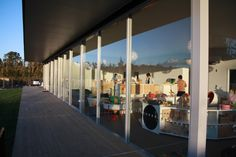 New Shoots Childrens Centre designed by Collingridge and Smith Architects. Equipped with floor to ceiling glass sliding doors and a wrapping deck that stretches onto grass and landscaped play areas.