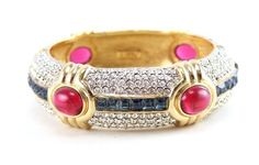 House of Lavande, 1970's Ciner jewel encrusted hinged cuff on gold setting with pave diamante, a center row of blue baguettes and pink cabochons.
