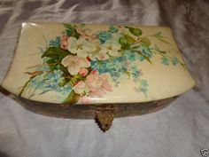 It is 9 by 7 by tall and has a chromolithograph print on top of a children tea party. The top also has an embossed violet motif border. The left top side edge has super slight lifting of celluloid not worth noting. Catherine Klein, Dresser, Cherry Apple, Jewel Box, Violets, Victorian Era, Tea Party, Art Nouveau, Jewels