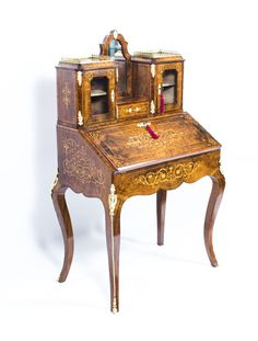 An antique Victorian inlaid bonheur du jour worthy of a museum.