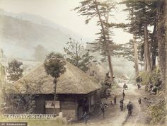 1890's. Sanmaibashi on the Tokaido. A beautiful view on a rural road near Sanmaibashi (三枚橋) in Yumoto (湯本), Hakone. The photographer (Nobukuni Enami) has caught the attention of a group of children, women, farmers and travelers standing on the road. They are clearly very curious. Located in Kanagawa Prefecture, not too far from Yokohama, Hakone was—and still is—a popular spa resort.