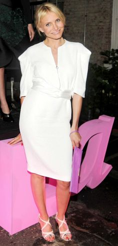 Cameron Diaz in our Spring 2014 belted dress and Winter 2013 Beckett clutch.