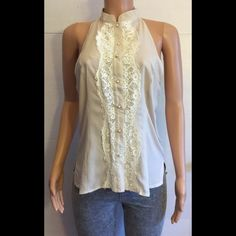 La festa lace tank top Beautiful button down hi-low top with lace down the center and down the back. Front neck to bottom is 22 inches. Back neck to bottom is 29 inches. 15% off bundles La festa Tops Tank Tops