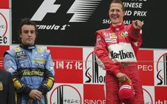 F1 Grand Prix of China...SHANGHAI, CHINA - OCTOBER 01: Michael Schumacher of Germany and Ferrari celebrates on the podium as Fernando Alonso looks on after the Formula One Chinese Grand Prix at Shanghai International Circuit on October 1, 2006 in Shanghai, China