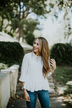 Fall perfection! White striped peplum with jeans and light brown caramel highlighted hair with loose curls.