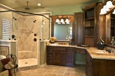 Love the setup of this master bath with the stand up shower in one corner then the his and her bathroom sinks in the other.