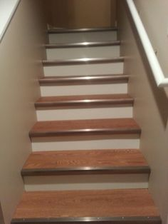 Beautiful Allure Vinyl Plank Flooring On The Basement Stairs