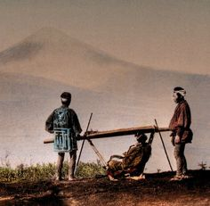Palanquin-bearers with woman on board take a rest, Mount Fuji in the background.  Hand-colored photo, late 19th century, Japan.  Image via ookami_dou of Flickr