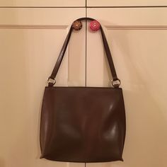 Furla leather pocketbook...never used! Beautiful espresso colored bag with two straps. Inner zippered pocket and magnetic closure. Silver hardware. Comes with dust bag. Furla Bags Shoulder Bags