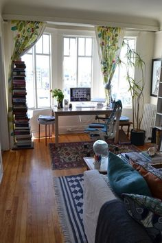 Natalie's Beach-Girl-Meets-Book-Nerd Nest House Tour | Apartment Therapy  Or, the importance of light.