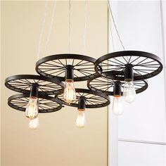 Vintage Spoke Wire Wheel Chandelier. Would love to find some old bicycle wheels to do this with!