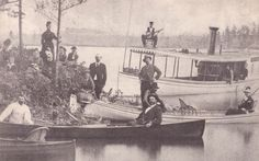 The late 19th century in the 1000 Islands was considered the heyday of the tourism industry. Here, early vacationers are pictured on a fishing expedition with some St. Lawrence skiffs as the steamer Reindeer, complete with musician, awaits their departure after a shore dinner.