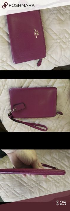 Coach wristlet new Coach wristlet new.  It is burgundy plum in color and has credit card slots inside Coach Bags Clutches & Wristlets