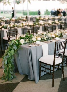 Simple sophistication: http://www.stylemepretty.com/2015/05/07/35-gorgeous-cascading-centerpieces/