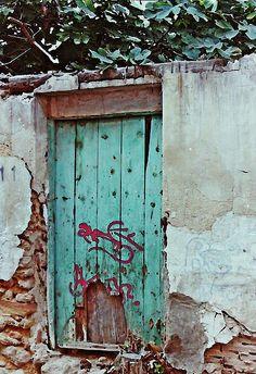 Old Door and Graffiti in Lorca Photograph by Sarah Loft