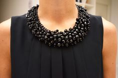 Do a necklace that somehow connects to the neckline, but is removable*