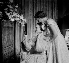 Gloria Vanderbilt poses in an 1830 beige wedding gown after exchanging vows with movie director Sidney Lumet on August 28 1956. Photographed by Gordon Parks for LIFE Magazine.