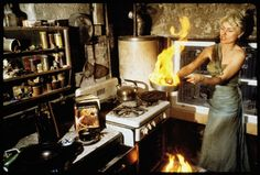 """""""Debbie with a frying pan after a fire burned down our apartment. That blue dress was allegedly worn by Marilyn Monroe in The Seven Year Itch, but it got badly singed. Fortunately, Debbie's cats were OK."""""""