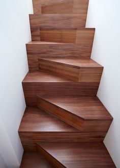 Designed by Michael Anastassiades, these mahogany stairs take less space than a conventional staircase.