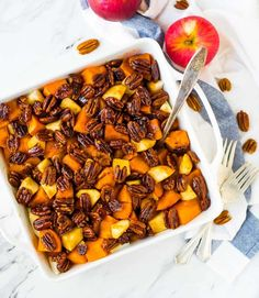 Honey Glazed Sweet Potatoes, oven baked with apples, butter, and a cinnamon whiskey sauce. Easy to make ahead and perfect for Thanksgiving or any holiday!