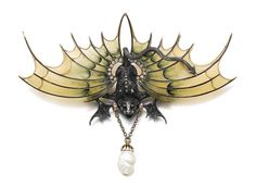 Enamel and diamond brooch, circa 1900 Designed as a gargoyle, the wings applied with plique-à-jour enamel and highlighted with circular- and single-cut diamonds, supporting a baroque shaped pearl, signed E.G., numbered, French assay mark.