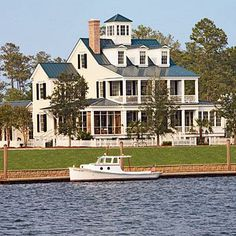 Captain's Watch | With broad front porches and generous windows, this home design demonstrates the timeless beauty of traditional design. Porch spaces live as comfortable, outdoor rooms, so always opt for all-weather furnishings and fabrics. | SouthernLiving.com