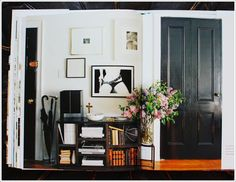 gallery wall with a black door
