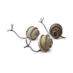 SNAIL SCULPTURE | Snail Sculpture - Handmade Stone and Steel Artwork Combines Rustic and Modern Charm | UncommonGoods found on Polyvore