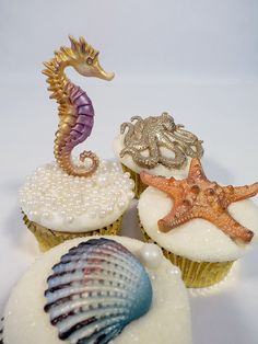 Ocean themed cupcakes by Just Cake. Decorated using Marvelous Molds' molds.