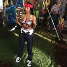 "Nicki Minaj mixing it up with Dickies Girls, Moschino and classic Chucks on the set of the ""Senile"" video."