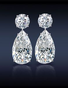 Jacob  Co. Teardrop Diamond Earrings. Two Brilliant Cut Pear Shape Diamonds, 12.31 Carats.  Topped With Two 3.16 Carat Round Brilliant Cut Diamonds mounted in 18K White Gold.