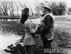 """Pam (Victoria Principal) considers a romantic overture from Ray (Steve Kanaly) in this 1978 publicity shot from """"Digger's Daughter,"""" """"Dallas's"""" first episode."""