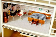 Back in February, I posted about the awesome tiny craft room created by Christine Ferrara of The Call of the Small. Things in miniature, especially for dollhouses, have always been one of my favori...