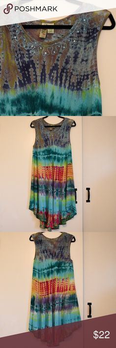 """India Boutique Tie Dye Boho Festival Dress VGUC Tie Dye Hippie Festival Dress from India Boutique  Light, gauzy, flowing free size dress with sequins and embroidery Tie dyed in beautiful shades of turquoise, blue, green, orange and magenta Worn a few times, hand washed and hung to dry Shoulder to shoulder approx 16"""" Armpit to armpit approx 22"""" Front neckline to hem approx 36"""" Back neckline to hem approx 40.5"""" Side seam armpit to hem approx 24"""" India Boutique Dresses Asymmetrical"""