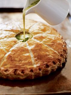 Fill a puff pastry pie with thinly sliced new potatoes, garlic, herbs and cream for a rich and creamy French-style dish.