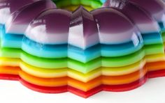 """Spiked Rainbow Ribbon Salad A classic layered gelatin dessert """"whoops it up"""" with the addition of your favorite flavored rum or vodka! Rainbow Jello, Rainbow Salad, Rainbow Treats, Rainbow Cakes, Rainbow Food, Jello Shots, Ribbon Salad Recipe, Rainbow Ribbon, Dessert Salads"""