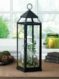 Gorgeous ! Create  your own style lanterns Create a candlelight display with this oversized and sleek black candle lantern. A perfect show stopper for any indoor or outdoor events.