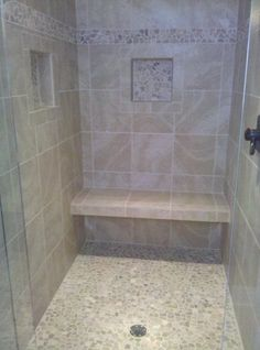 "Bench open underneath for more visual space    Shower stall with 12""x12"" tiles set straight with Bali Cloud pebbles on floor and as decorative border."